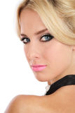 Stylish girl. Portrait of beautiful blond girl with stylish makeup looking over her shoulder royalty free stock photo