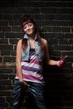 Stylish girl against black brick wall Stock Photos