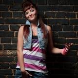 Stylish girl against black brick wall Stock Image