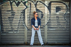 Stylish girl on a background of a wall Royalty Free Stock Photography