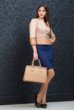 Stylish girl with a bag Stock Images