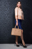 Stylish girl with a bag Royalty Free Stock Photo