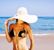 Stylish girl on the beach Stock Image
