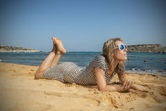 Stylish girl at the beach Royalty Free Stock Images