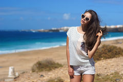 Stylish girl at beach Royalty Free Stock Images