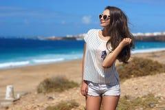 Stylish girl at beach Royalty Free Stock Photo
