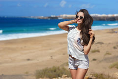 Stylish girl at beach Royalty Free Stock Photography