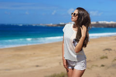 Stylish girl at beach Stock Photos