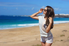Stylish girl at beach Stock Photography