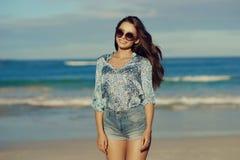 Stylish girl at beach Stock Image