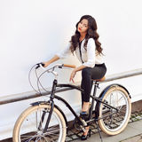 Stylish girl with bike Royalty Free Stock Photo