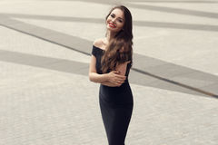 Stylish girl in black dress Royalty Free Stock Image
