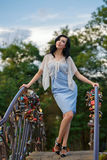 Stylish girl on the bridge. Royalty Free Stock Photography