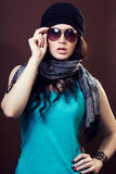 Stylish girl on a brown background Stock Photography