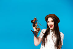 Stylish girl with camera. Blue background. Summer Stock Images