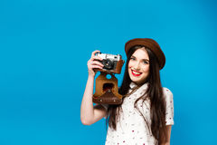 Stylish girl with camera. Blue background. Summer Royalty Free Stock Photos