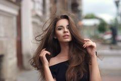 Stylish girl in city Stock Photos