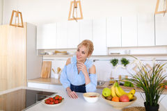 Stylish girl cooks posing for breakfast in morning, standing at Stock Images