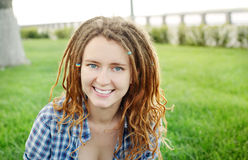 Stylish girl with dreadlocks outdoors. Stock Photos