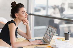 Stylish girl dreaming on her workplace Royalty Free Stock Image