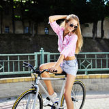 Stylish girl on a fixed gear bicycle outdoor Royalty Free Stock Photo