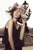 Stylish girl with floral hat Stock Photography