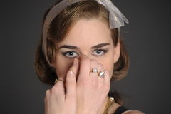 Stylish girl with golden rings Stock Photos
