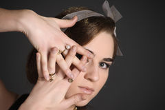 Stylish girl with golden rings Stock Images