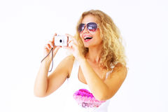 Stylish girl holding a camera Stock Photos