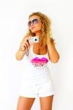 Stylish girl holding a camera Royalty Free Stock Image