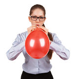 Stylish Girl Inflates A Big Red Ball Stock Photos