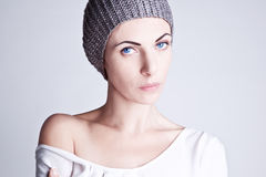 Stylish girl in a knitted hat Stock Images