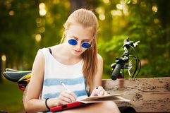 Stylish  girl  learns lessons. Stock Images