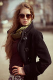 Stylish girl with long hair wearing sunglasses Royalty Free Stock Photos