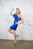 Stylish  Girl in luxurous blue dress Stock Photo