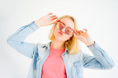 Stylish girl making faces. A portrait of a stylish girl making faces Royalty Free Stock Photo