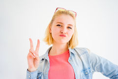Stylish girl making faces. A portrait of a stylish girl making faces Royalty Free Stock Image