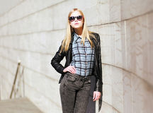 Stylish girl model posing in the city Royalty Free Stock Photography