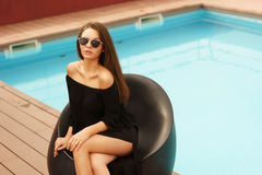 Stylish girl near pool Royalty Free Stock Photo