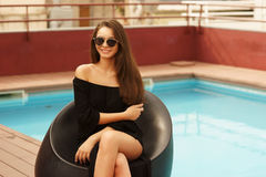 Stylish girl near pool Stock Photo