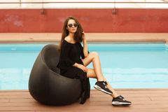 Stylish girl near pool Royalty Free Stock Photography