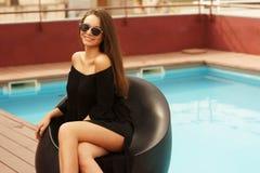 Stylish girl near pool Royalty Free Stock Image