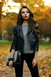 Stylish girl in park Stock Photography