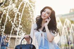 Stylish girl on the phone. Stock Photos