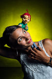Stylish girl playing with a puppet Stock Photography