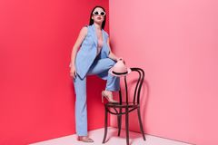 Stylish girl posing with chair Stock Photos