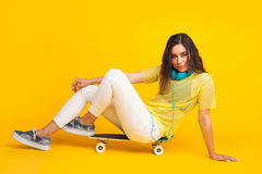 Stylish girl posing on skate Stock Photos