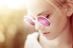 Stylish girl with purple round retro sunglasses Royalty Free Stock Images