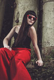 Stylish girl in red pants and glasses Royalty Free Stock Images