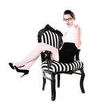 Stylish girl in retro chair Royalty Free Stock Photos
